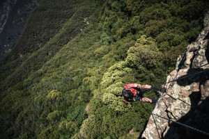 Adventure racer rappelling down a cliff